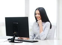 Smiling businesswoman or student with computer Stock Photography