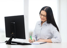 Smiling businesswoman or student with eyeglasses Stock Photos