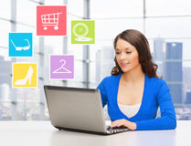 Smiling businesswoman or student with laptop Stock Photography