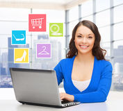 Smiling businesswoman or student with laptop Stock Image