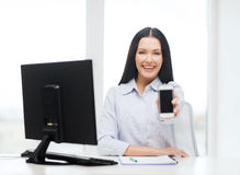 Smiling businesswoman or student with smartphone Royalty Free Stock Photos