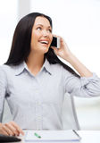 Smiling businesswoman or student with smartphone Royalty Free Stock Images