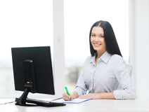 Smiling businesswoman or student studying Royalty Free Stock Photography