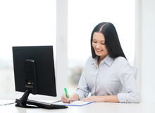Smiling businesswoman or student studying Royalty Free Stock Images