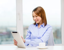 Smiling businesswoman or student with tablet pc Royalty Free Stock Photography