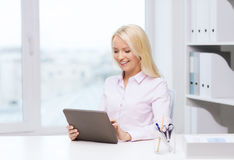 Smiling businesswoman or student with tablet pc Royalty Free Stock Images