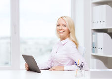 Smiling businesswoman or student with tablet pc Royalty Free Stock Image