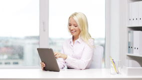 Smiling businesswoman or student with tablet pc stock video