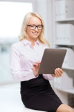 Smiling businesswoman or student with tablet pc Royalty Free Stock Photos