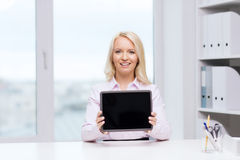 Smiling businesswoman or student with tablet pc Stock Photo