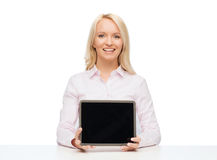 Smiling businesswoman or student with tablet pc Stock Image
