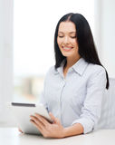 Smiling businesswoman or student with tablet pc Stock Photos