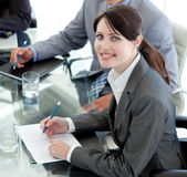 Smiling businesswoman studying a document stock photo