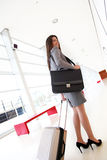 Smiling businesswoman with suitcase going travelling Royalty Free Stock Photos