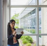 Smiling student inside college stock photos