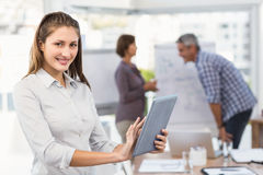 Smiling businesswoman with tablet in a meeting Royalty Free Stock Photo