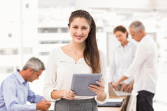 Smiling businesswoman with tablet in a meeting Stock Photo