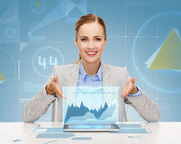 Smiling businesswoman with tablet pc. Business, technology, internet and office concept - smiling businesswoman with tablet pc computer Stock Photo