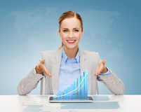 Smiling businesswoman with tablet pc. Business, technology, internet and office concept - smiling businesswoman with tablet pc computer and increasing chart Stock Images