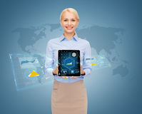 Smiling businesswoman with tablet pc computer. Business, office, technology and development concept - smiling businesswoman showing tablet pc computer screen Stock Photo
