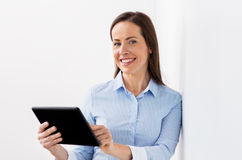 Smiling businesswoman with tablet pc computer Stock Photos