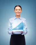 Smiling businesswoman with tablet pc and graph Royalty Free Stock Photo
