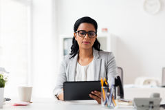 Smiling businesswoman with tablet pc at office Royalty Free Stock Photo