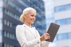 Smiling businesswoman with tablet pc outdoors Royalty Free Stock Photography