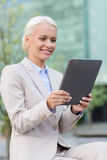 Smiling businesswoman with tablet pc outdoors Stock Photography
