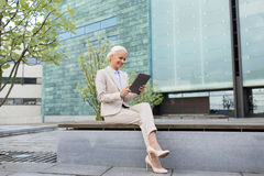 Smiling businesswoman with tablet pc outdoors Stock Image
