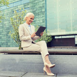 Smiling businesswoman with tablet pc outdoors Royalty Free Stock Photo