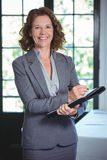 Smiling businesswoman taking notes. In a restaurant Royalty Free Stock Photo