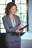 Smiling businesswoman taking notes. In a restaurant Royalty Free Stock Image