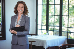 Smiling businesswoman taking notes. In a restaurant Royalty Free Stock Photos