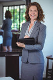 Smiling businesswoman taking notes. In a restaurant Stock Photography
