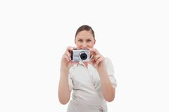 Smiling businesswoman taking a picture Royalty Free Stock Photos