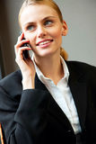 Smiling businesswoman talking on cell phone Stock Photos