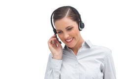 Smiling businesswoman talking on headset Royalty Free Stock Image