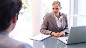 Smiling businesswoman talking with an man stock video footage