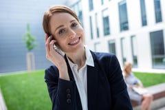 Smiling businesswoman talking on mobile phone Royalty Free Stock Photos