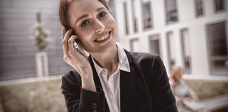 Smiling businesswoman talking on mobile phone. Portrait of smiling businesswoman talking on mobile phone Royalty Free Stock Photo
