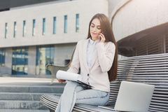 Caucasian businesswoman working with papers outdoors Royalty Free Stock Photography