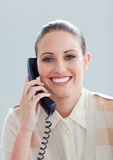 Smiling businesswoman talking on phone Stock Image
