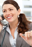Smiling businesswoman talking on the phone Stock Image