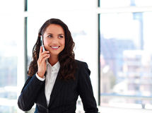 Smiling businesswoman talking on phone Royalty Free Stock Image