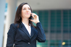 Smiling businesswoman talking on the phone Royalty Free Stock Image