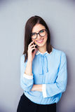 Smiling businesswoman talking on the phone Stock Photo