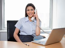 Smiling Businesswoman Talking On Phone Royalty Free Stock Images