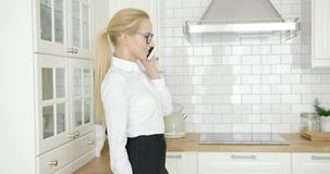 Smiling businesswoman talking by phone stock video