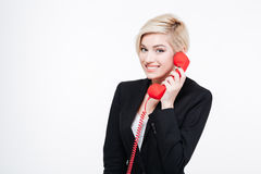 Smiling businesswoman talking on the phone tube Stock Photo
